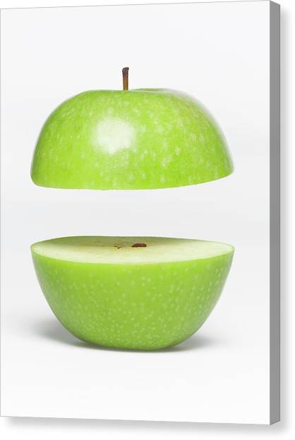 Two Parts Of Apple With Copyspace Canvas Print by Jazzirt