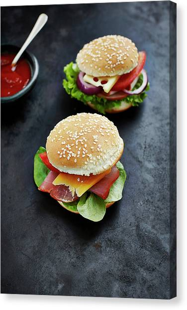 Buns Canvas Print - Two Prepared Burgers, Mustard And by Westend61