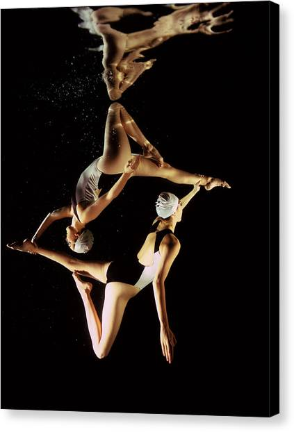 Two Synchronised Swimmers, Underwater Canvas Print by Zac Macaulay