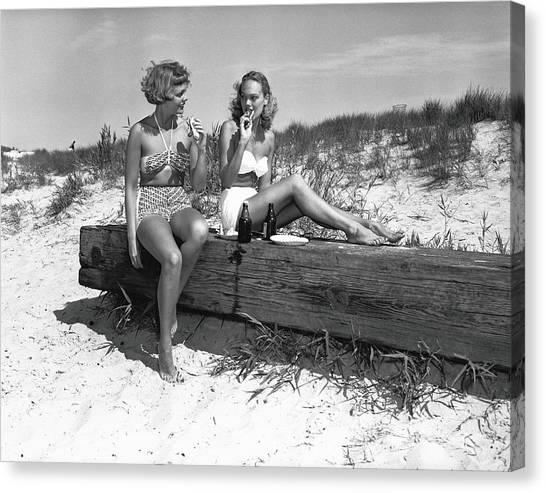 Two Women In Bikini Eating Snack On Canvas Print