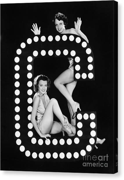 Indoors Canvas Print - Two Young Women Posing With The Letter C by Everett Collection