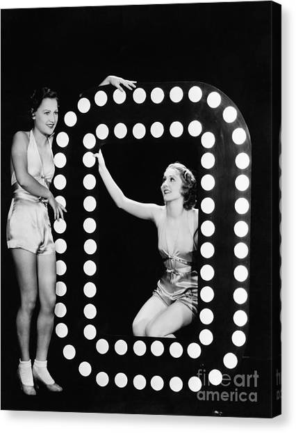 Indoors Canvas Print - Two Young Women Posing With The Letter O by Everett Collection