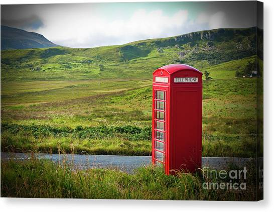 Typical Red English Telephone Box In A Rural Area Near A Road. Canvas Print