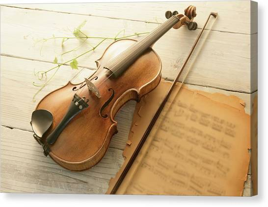 Violin And Music Sheet Canvas Print by Image Work/amanaimagesrf