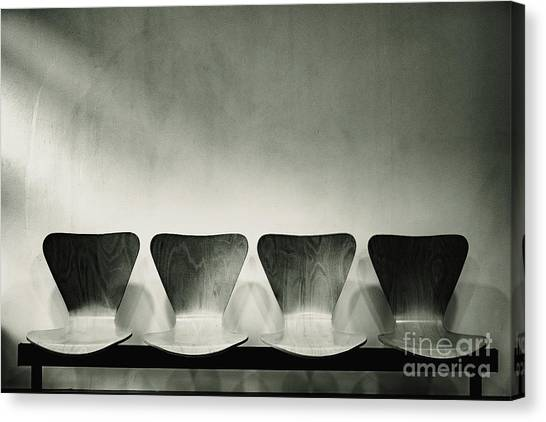 Waiting Room With Empty Wooden Chairs, Concept Of Waiting And Passage Of Time, Black And White Image, Free Space For Text. Canvas Print