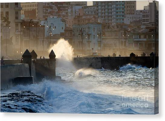 Tides Canvas Print - Waves Crashing Against The Sea Wall Of by Corlaffra