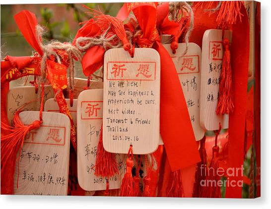 Worship Canvas Print - Wish Cards In A Buddhist Temple In by Praphat Rattanayanon
