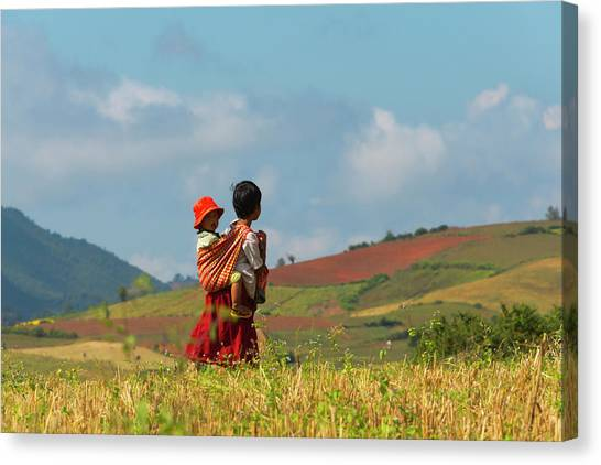 Woman Carrying Baby In The Mountain Canvas Print