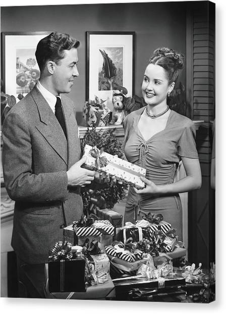 Woman Giving Gift To Man, B&w Canvas Print by George Marks