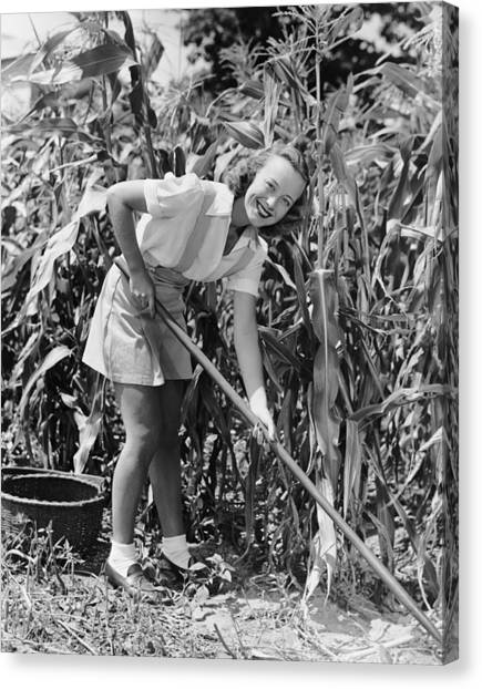 Woman Hoeing In Field Of Corn By George Marks