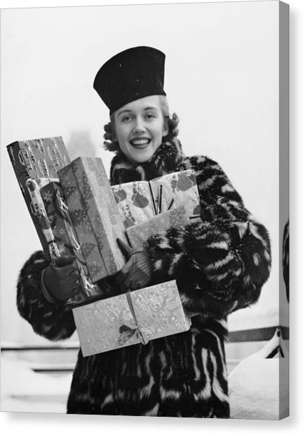 Woman In Fur Coat Holding Christmas Canvas Print