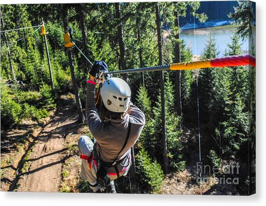 Mountain Climbing Canvas Print - Woman Sliding On A Zip Line In An by Alxcrs