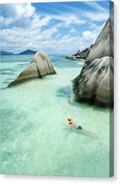Woman Swimming Close To Shore Beside Canvas Print