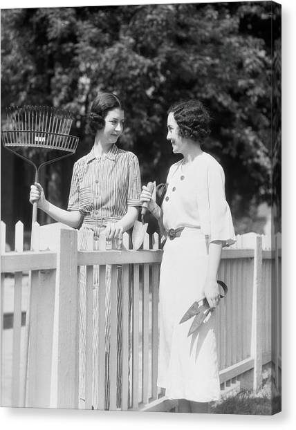 Women Chatting Over Fence Canvas Print by H. Armstrong Roberts