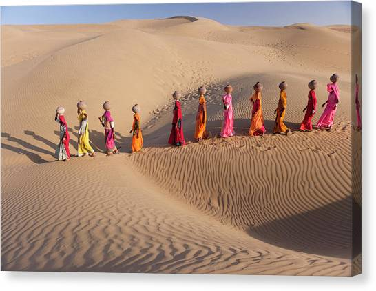 Women Fetching Water From The Sparse Canvas Print by Mint Images - Art Wolfe