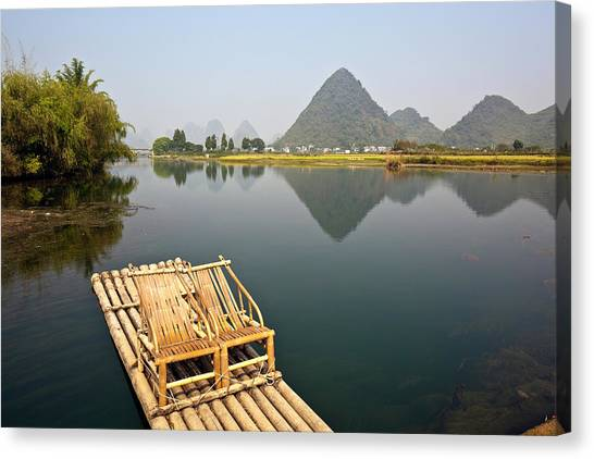 Yangshuo, Bamboo Raft On The Yulong Canvas Print