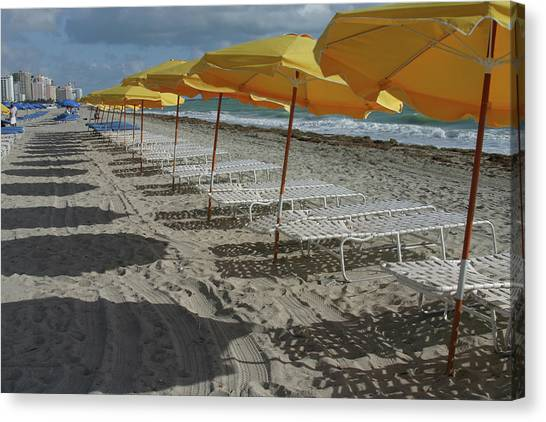 Yellow Umbrellas In South Beach Canvas Print by Theresemck