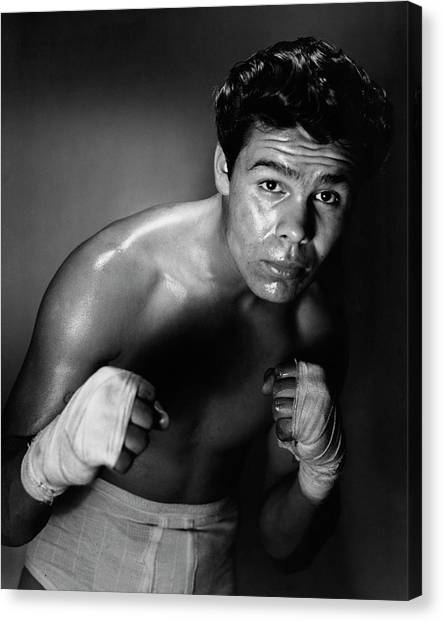 Young Adult Man In A Fighting Stance Canvas Print by Superstock