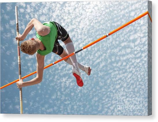 Jump Canvas Print - Young Athletes Pole Vault Seems To by Mezzotint