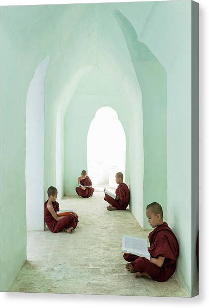 Young Buddhist Monks Reading In Temple Canvas Print