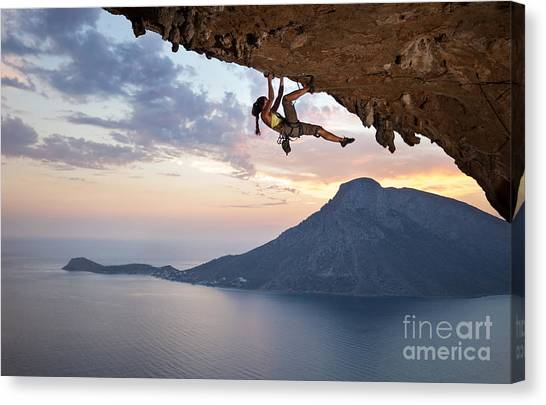 Mountain Climbing Canvas Print - Young Female Rock Climber At Sunset by Photobac