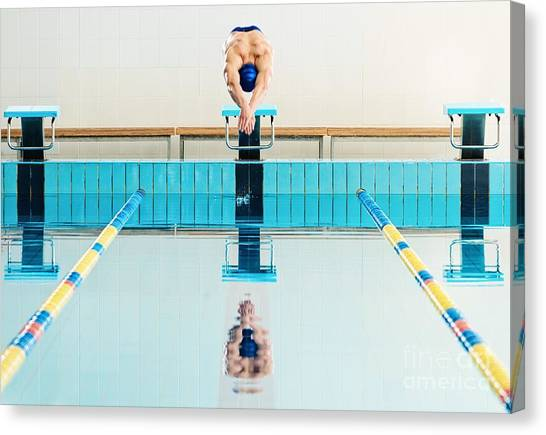 Exercising Canvas Print - Young Muscular Swimmer Jumping From by Nejron Photo