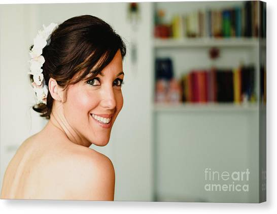 Young Woman From Behind Smiling Canvas Print