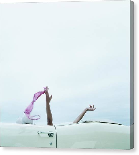 Young Woman In Convertible Car, Arms Canvas Print