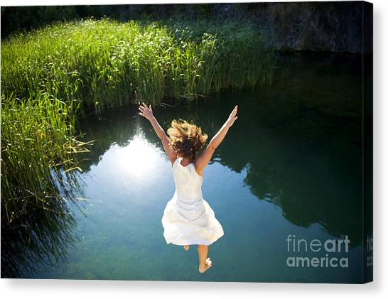 Dress Canvas Print - Young Woman In White Dress Jumping Into by Luna Vandoorne