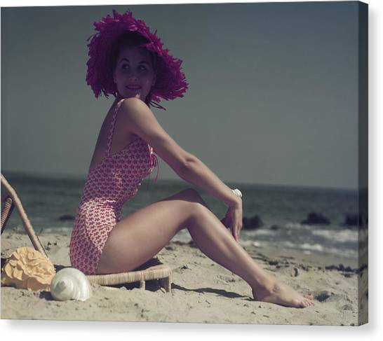 Young Woman Sitting On Lounge Chair On Canvas Print