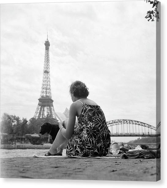 Young Woman Taking In The Sun On The Canvas Print by Keystone-france