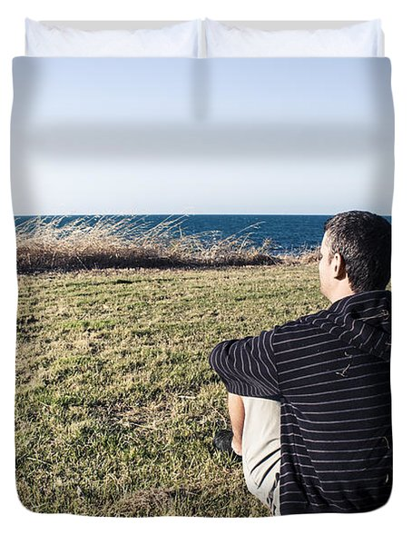 Caucasian Traveler Relaxing On Grass Outdoors Duvet Cover