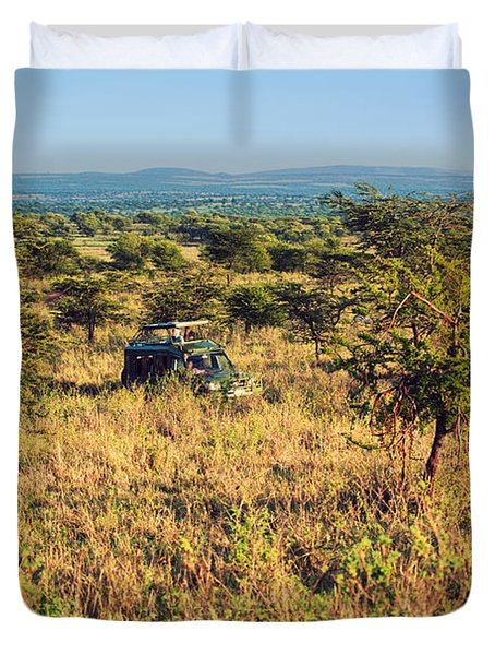 Jeep With Tourists On Safari In Serengeti. Tanzania. Africa. Duvet Cover by Michal Bednarek