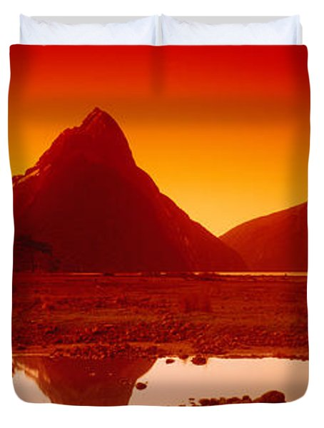 Reflection Of Mountains In A Lake Duvet Cover by Panoramic Images