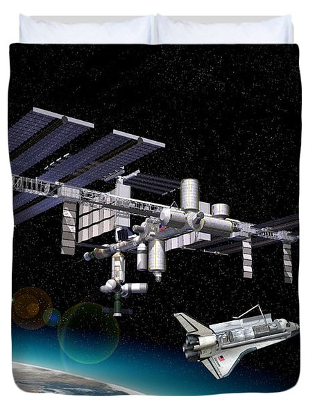 Space Station In Orbit Around Earth Duvet Cover by Leonello Calvetti