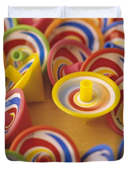 Spinning Tops Duvet Cover by Jim Corwin