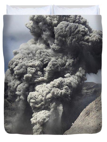 Ash Cloud Rises From Crater Of Batu Duvet Cover by Richard Roscoe