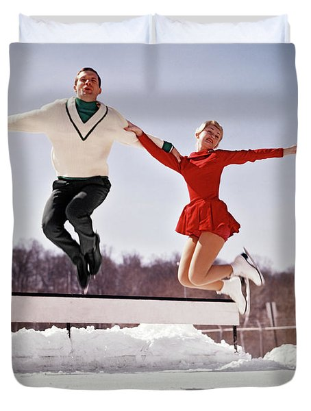 1960s Man And Woman Ice Skaters Jumping Duvet Cover