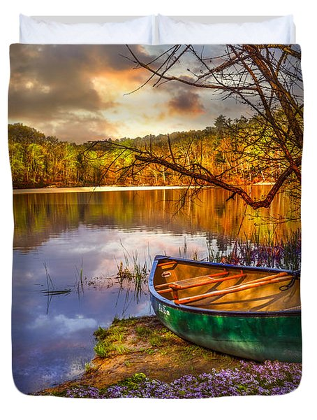 Canoe At The Lake Duvet Cover by Debra and Dave Vanderlaan