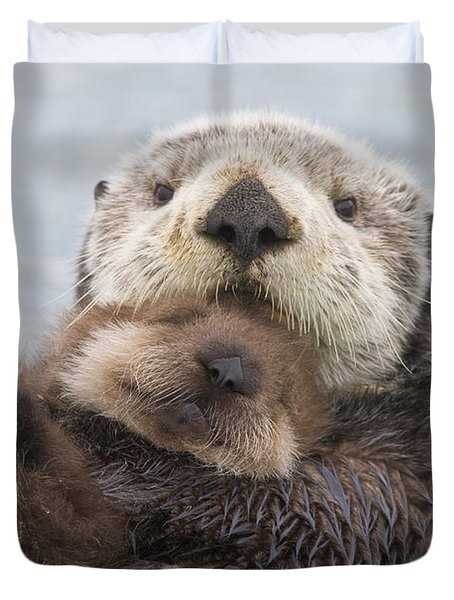 Female Sea Otter Holding Newborn Pup Duvet Cover