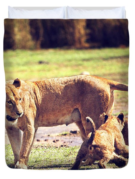Small Lion Cubs With Mother. Tanzania Duvet Cover by Michal Bednarek