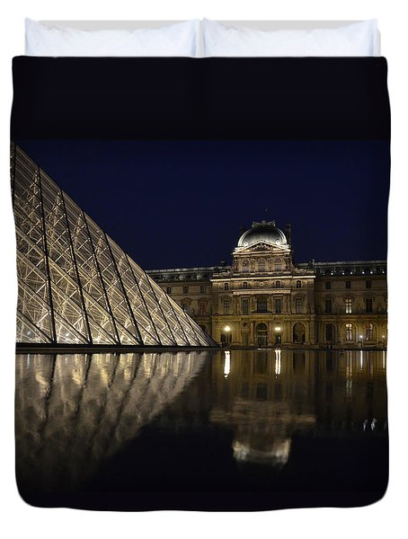 The Louvre Palace And The Pyramid At Night Duvet Cover