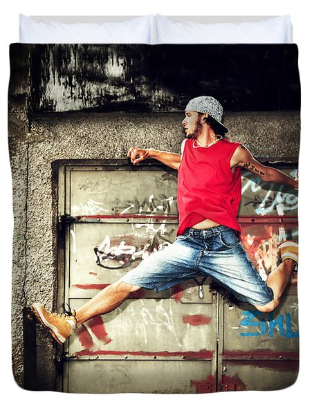 Young Man Jumping On Grunge Wall Duvet Cover by Michal Bednarek