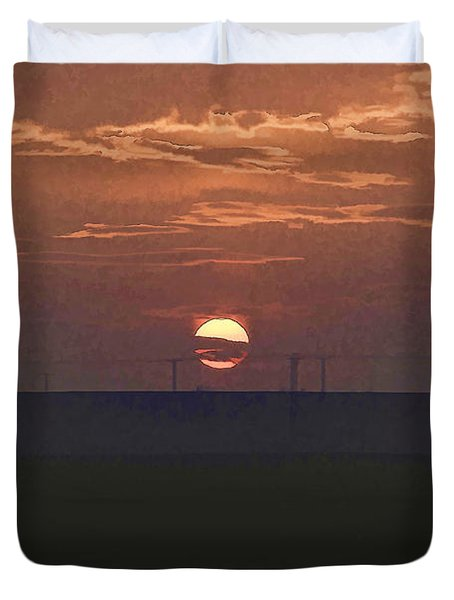 The Setting Sun In The Distance With Clouds Duvet Cover