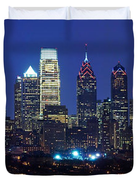 Buildings Lit Up At Night In A City Duvet Cover by Panoramic Images
