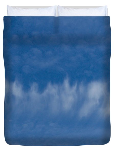 Duvet Cover featuring the photograph A Batch Of Interesting Clouds In A Blue Sky by Eti Reid
