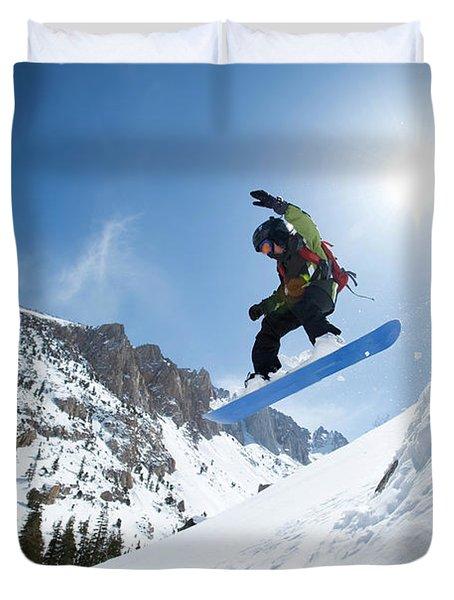 A Boy Snowboarding In The California Duvet Cover