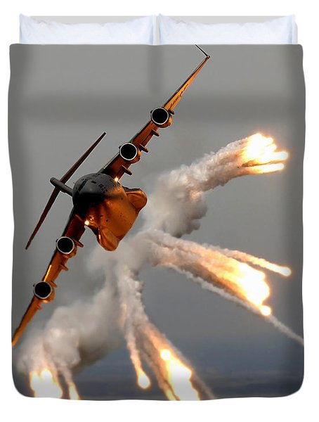 Duvet Cover featuring the photograph A C-17 Globemaster IIi Releases Flares by Stocktrek Images