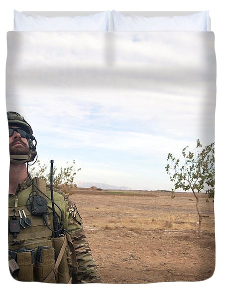A Coalition Force Member Looks For Air Duvet Cover by Stocktrek Images