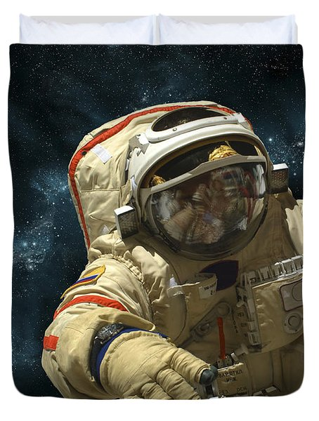 A Cosmonaut Against A Background Duvet Cover by Marc Ward